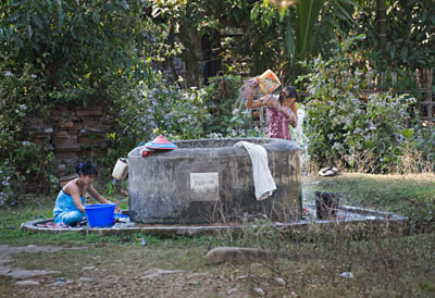 Women at the village well bathe just like their predecessors a hundred years ago @ Birgit Neiser