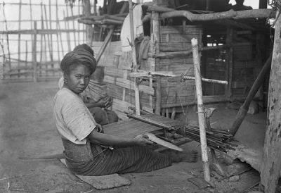 Kachin woman seated at a backstrap loom @ Christine Scherman