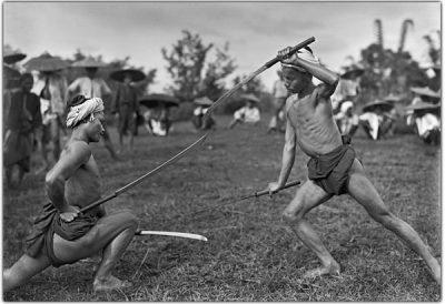 Two Shan men in a pose in ritual swordplay @ Christine Scherman