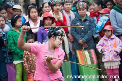 Shan girl participating in ritual swordplay @ Birgit Neiser