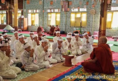 Men praying in Ya Tar Pagoda during the Phaung Daw U Pagoda Festival at Inle Lake @ Birgit Neiser