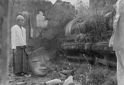 Broken Buddha figure in ruins of a temple in Sagaing, west of Mandalay @ Christine Scherman