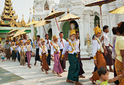 Novices decorated with golden tinsel on the way to the Shwedagon Pagoda, Yangon @ Birgit Neiser